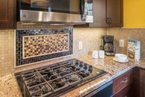 Kitchen Remodeling - custom tile background - Exodus Construction - luxury coastal homes