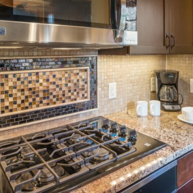 Kitchen Remodeling - custom tile background - Exodus Construction - luxury coastal homes