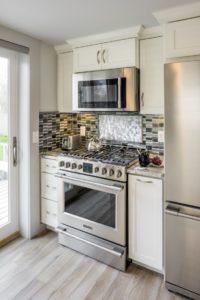 Kitchen Remodeling - Stove countertop with tile backsplash - Exodus Construction - luxury coastal homes