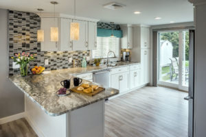 Custom sliding door off kitchen - Exodus Construction - luxury coastal homes builder South County RI